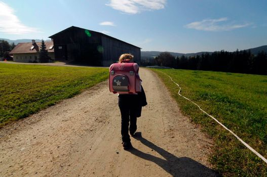 school child on the way to school in the countryside