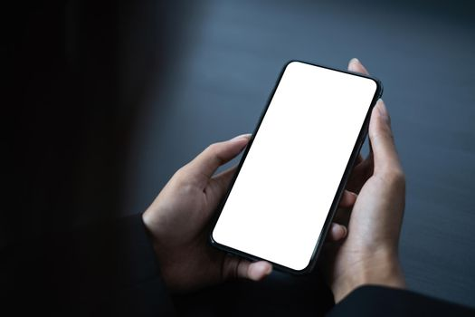 A Man hand holding smartphone device with blank screen.