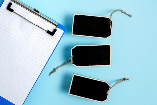Collection of Real Blank Empty Sticker Card Tag With An Elastic Band On A Different Color Background Containing Modern Gadget Checklist For Labeling Informative Content Purposes
