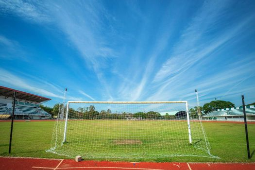 Stadium Soccer goal or football goal at of stadium with blue sky background.