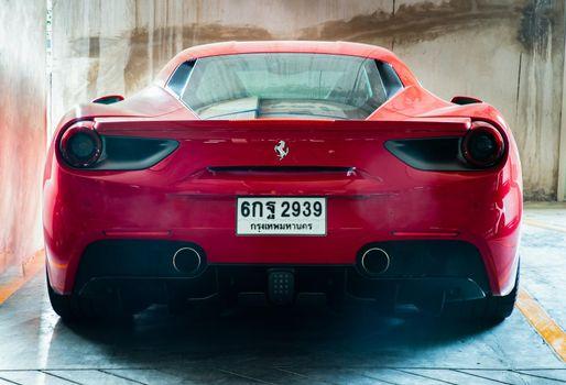 Bangkok, Thailand - 06 Jun 2021 : Rear view of Red metallic Ferrari car. Ferrari is Italian sports car. Selective focus.