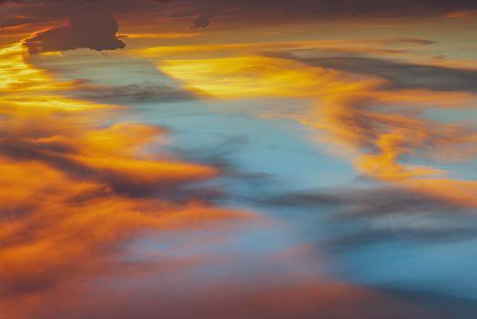 Beautiful sunset sky above clouds with dramatic light, Beautiful blazing sunset landscape, Copy space, Selective focus.