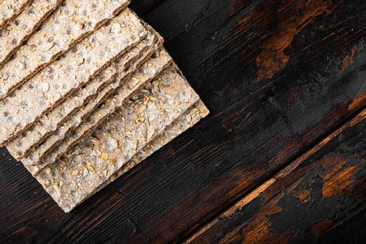 Low calories snack bread, on old dark wooden table background, top view flat lay, with copy space for text