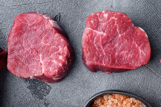Prime Raw Fillet Mignon tenderloin steaks, on gray stone background, top view flat lay