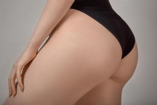 Beautiful slim and curvy body in black bodysuit