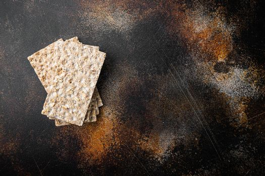 Low calories snack bread, on old dark rustic table background, top view flat lay, with copy space for text