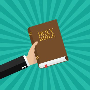 Hand holding holy bible