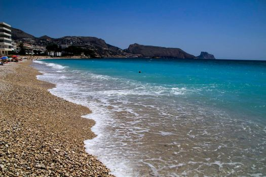 Beautiful Cap Negret beach on a sunny day of Spring in Altea, Alicante, Spain