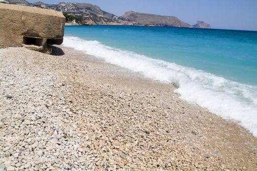 Cap Negret beach and Civil War bunker on a sunny day of Spring in Altea, Alicante, Spain.