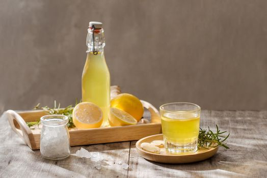Ginger Ale - Homemade lemon and ginger organic soda drink, copy space.