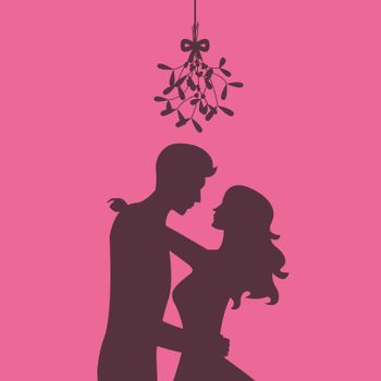 Silhouette of Loving couple are kissing under the mistletoe