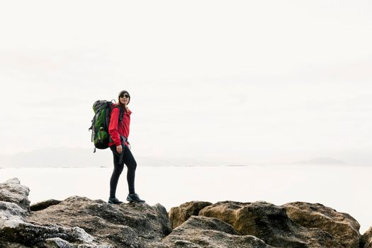 Woman exploring the coast