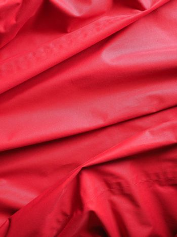 rippled red polyester fabric texture background