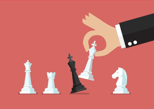 Businessman hand use white king checkmate the black king