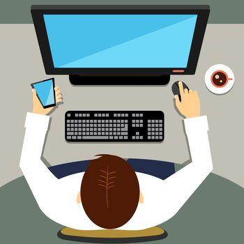 Man working on desktop computer with blank screen