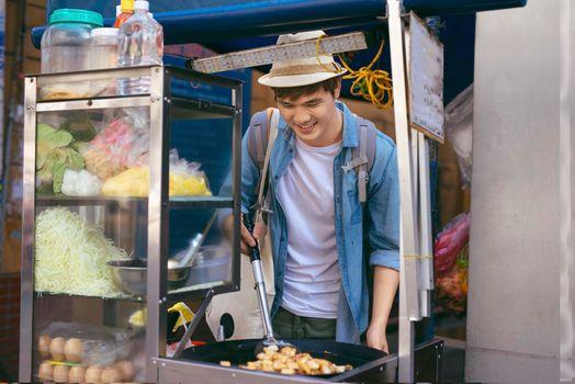 Ho chi minh City, Vietnam - Travel men - Bot chien is street foods in Vietnam.