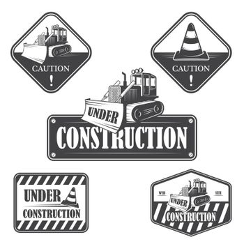 Set of under construction emblems, labels and designed elements