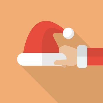 Santa hand holding Santa hat