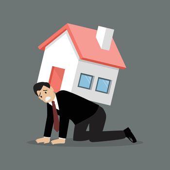 Desperate businessman carry a heavy home