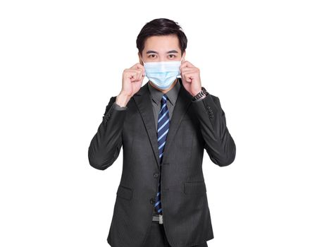 young businessman wears  medical mask for protection, and  both hands to check