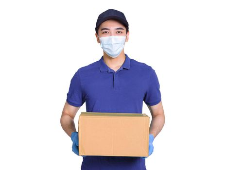 Young courier, employed in a logistics company, wearing blue clothes and hats, protective masks and gloves to protect himself, delivering packages during the covid-19 epidemic.