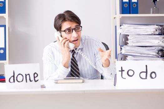 Businessman failing to deliver his to-do list