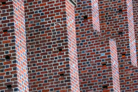 Close-up on the wall of a red brick building. Background.