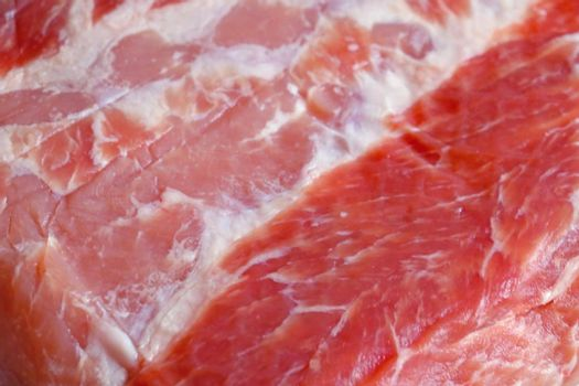 Close-up on a piece of meat on the table. Texture.
