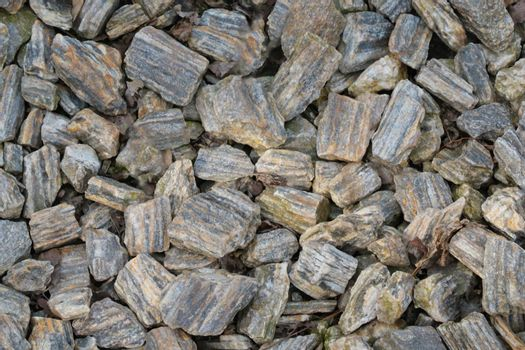Top view of small pieces of rock on the ground. Background, texture of stone.