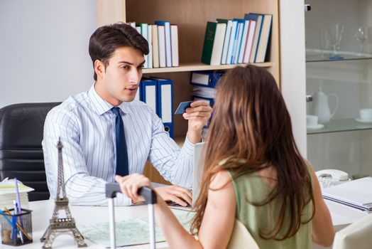 Customer visiting travel agency and talking to agent
