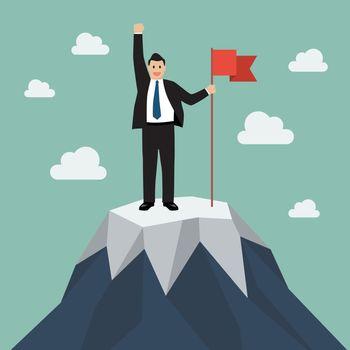 Businessman with flag on a Mountain peak