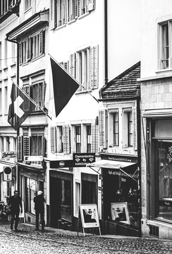 Vintage monochrome view of historic Old Town, shops and luxury stores near main downtown Bahnhofstrasse street, Swiss architecture and travel destination in Zurich, Switzerland