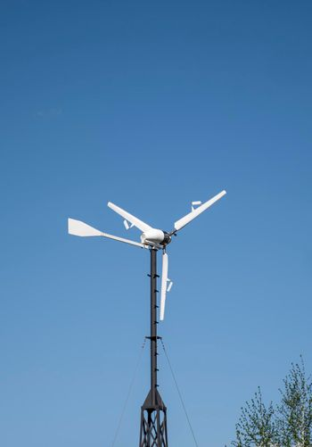 Windmill for renewable electric energy production in a private sector.