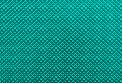 Abstract background of teal scale pattern
