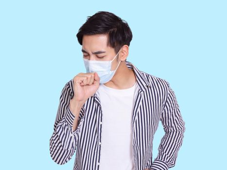 young man coughs and wears a protective medical mask to prevent infection