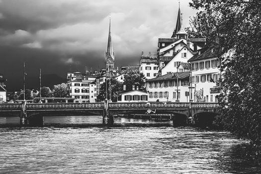 Vintage monochrome view of historic Old Town streets and buildings near main train station Zurich HB, Hauptbahnhof, Swiss architecture and travel destination in Zurich, Switzerland