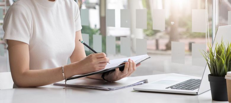 Businesswoman work with paper document on clipping board in office