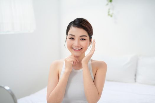 Female enjoying with healthy glowing skin after daily beauty routine and cosmetology treatment.