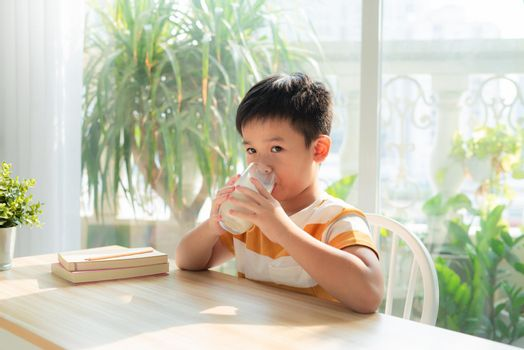 Boy drinking milk, calcium nutrition for healthy body and mind development