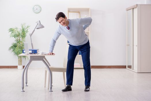 Employee suffering from backpain in office