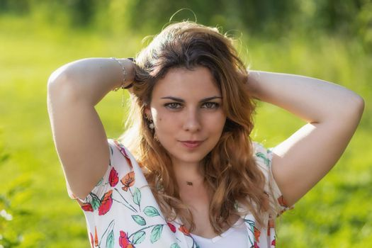 Atractive beautiful  young woman is posing outdoors.