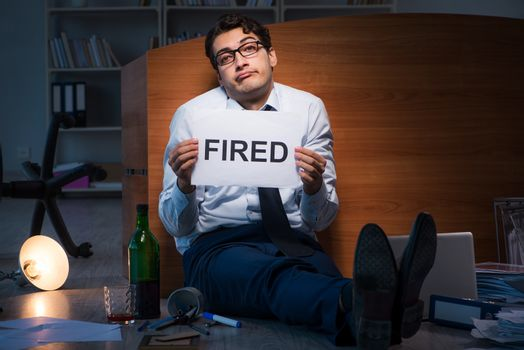 Employee fired during crisis drinking in stress and despair