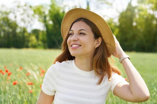 Restoring herself to nature after pandemic. Young woman breathing and relaxing in nature.