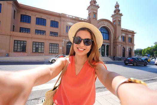 Visiting Bari. Self portrait of smiling young traveler woman enjoying visiting Bari, Apulia, Italy.