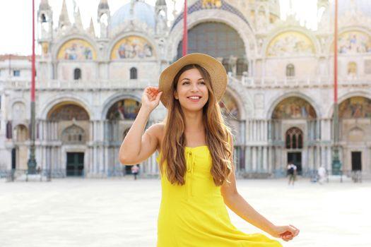 Pretty girl strolling alone in Venice, Italy