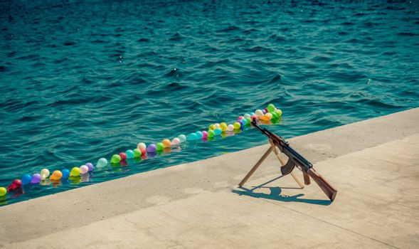 Balloon on a string for shooting game on water