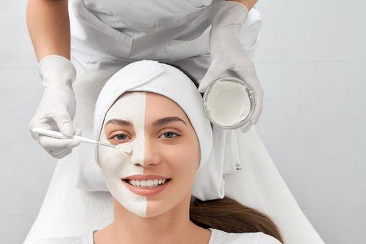 Attractive woman doing procedure for rejuvenation in salon.