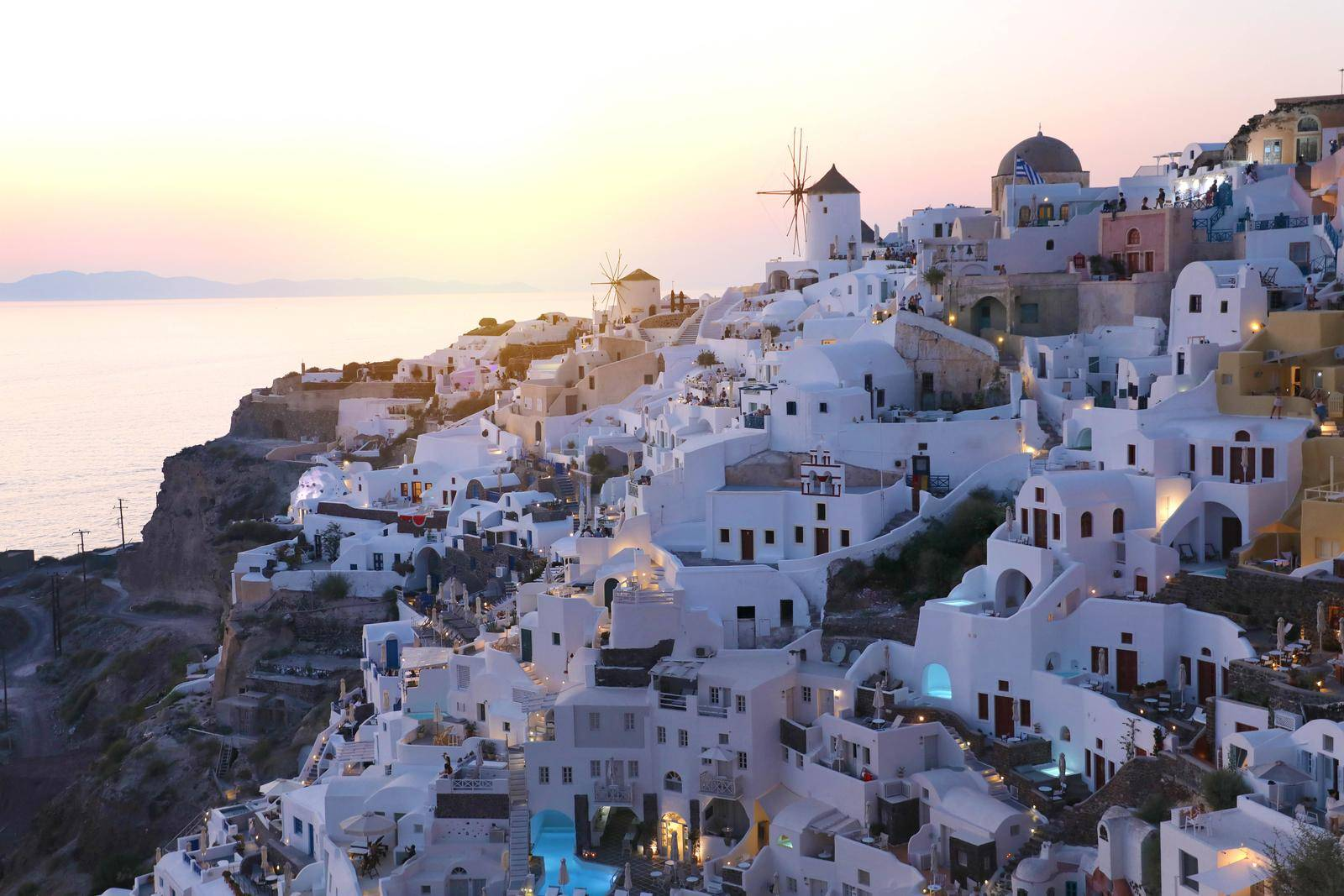 Fabulous picturesque village of Oia in Santorini island at sunset, Greece
